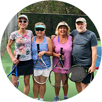 friends playing tennis at club